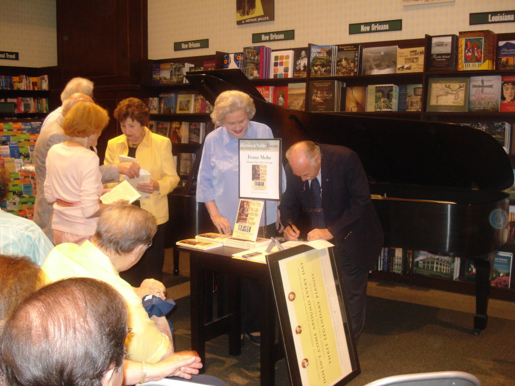 "Franz signing copies of his book ""My Life With The Great Pianists"""