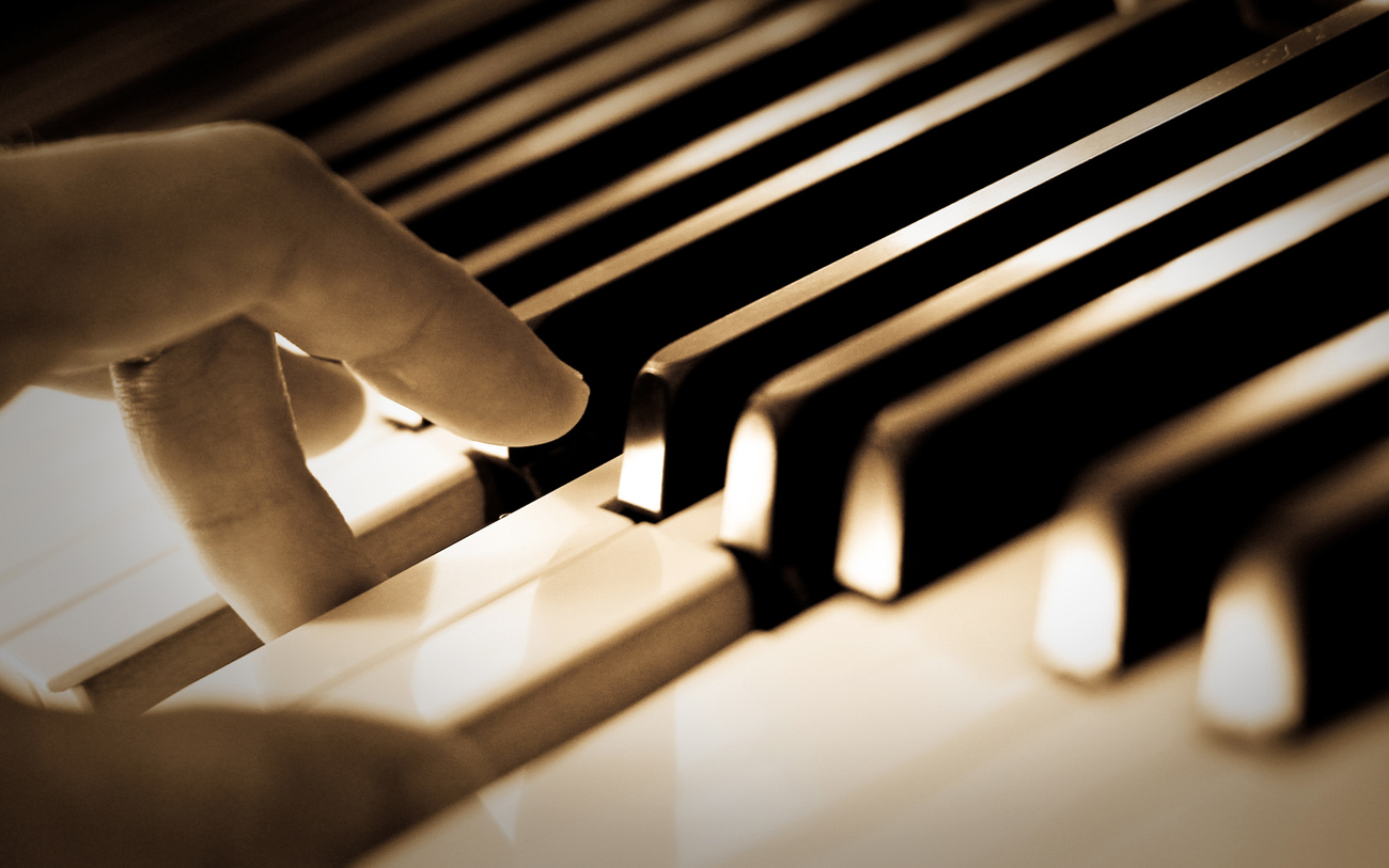 Touching Piano Key For Piano Lessons Image - Hall Piano Company